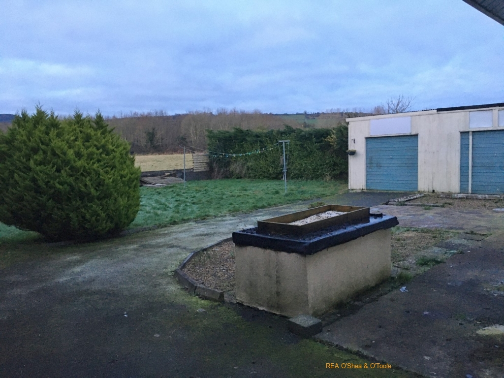 Back garden with double garage
